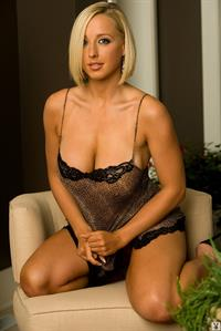 Jessica Mitchell poses in black lingerie