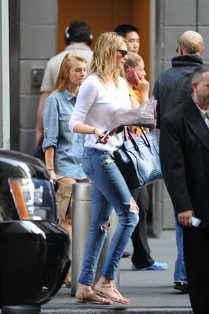 Kate Upton on her phone in New York City on June 21, 2013