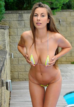 Connie carter strips her micro bikini poolside