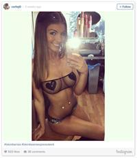 Carlie Jo in lingerie taking a selfie