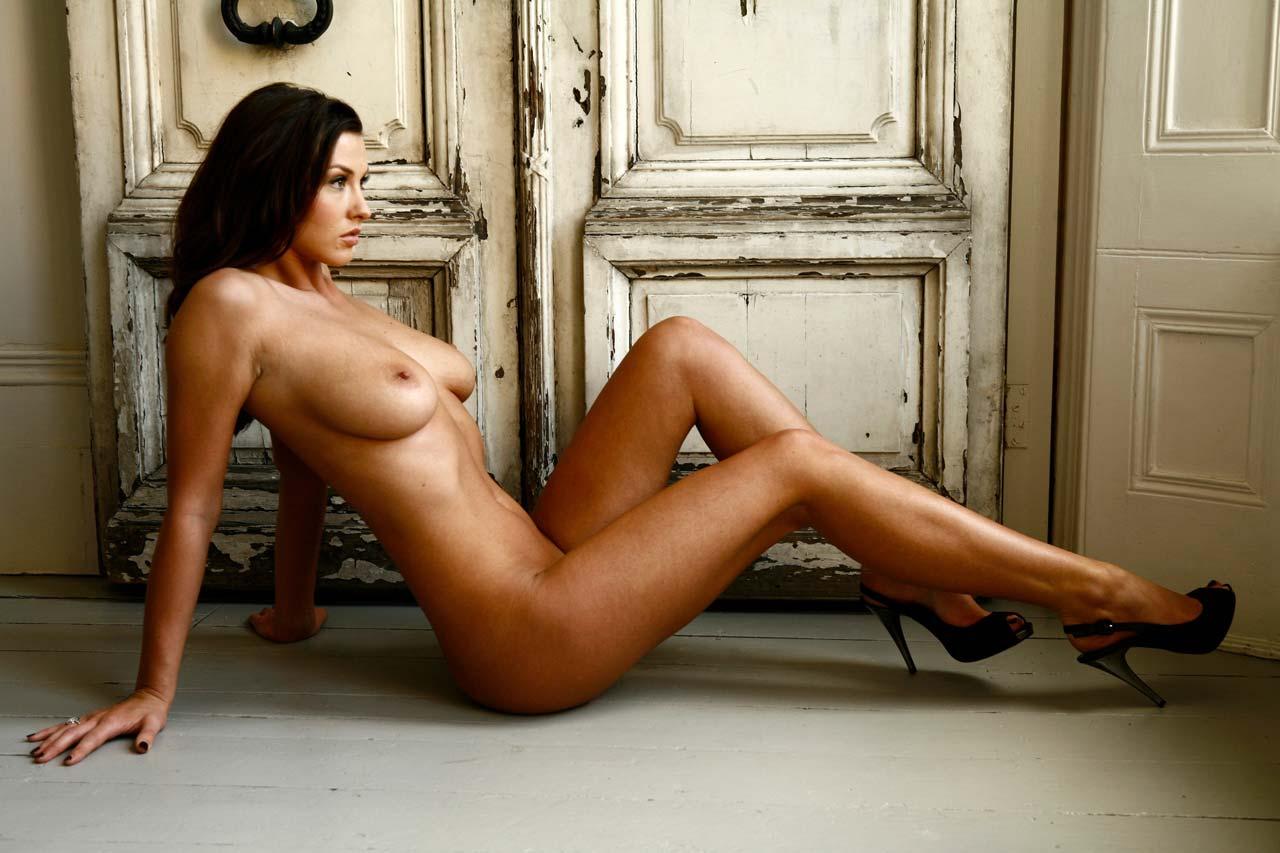 Alice Goodwin in front of old wooden doors