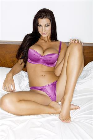 Alice Goodwin posing on a white bed