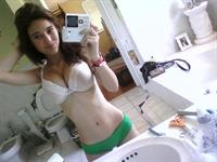 Angie Varona in lingerie taking a selfie