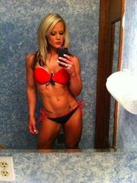 Nicole Wilkins in a bikini taking a selfie