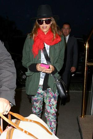 Jessica Alba arrives for an early morning flight at LAX, June 10, 2014
