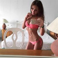 Galina Dubenenko in a bikini taking a selfie