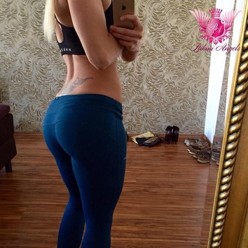 Adrienne Koleszár taking a selfie and - ass