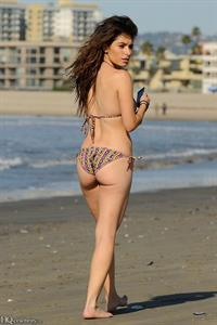 Sarah Shahi in a bikini - ass