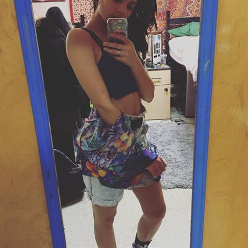 Sasha Lane taking a selfie
