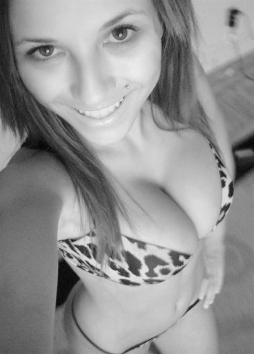 Jamilya Damon in a bikini taking a selfie