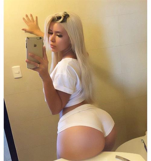 Cecibel Vogel taking a selfie and - ass
