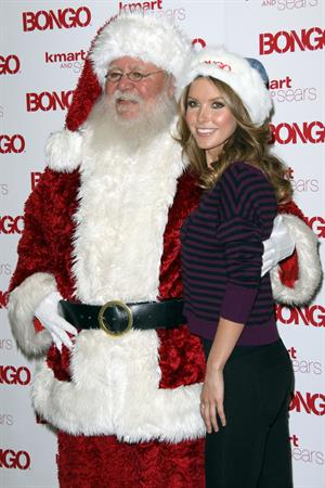 Audrina Patridge poses with Santa Claus