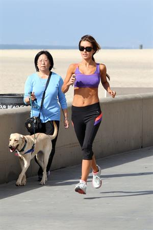 Audrina Patridge running on the beach in the South Bay