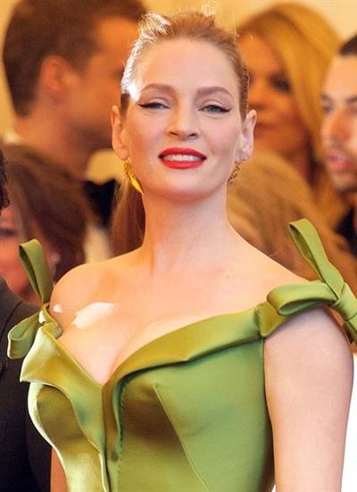 Uma Thurman in a green dress