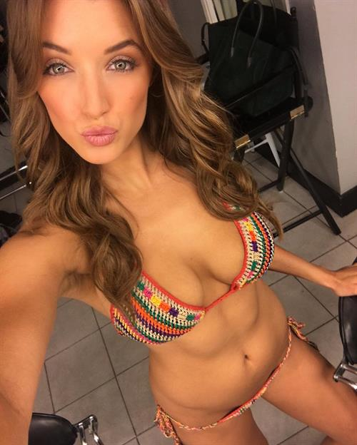 Alyssa Arce in a bikini taking a selfie