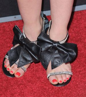 Lucy Hale showing off the shoes she wore at the Scream 4 Premiere at Graumans Chinese Theatre in Hollywood April 11, 2011