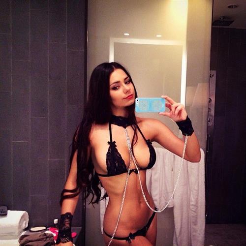 Helga Lovekaty in a bikini taking a selfie