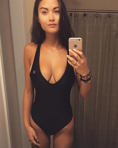 Keilah Kang in a bikini taking a selfie