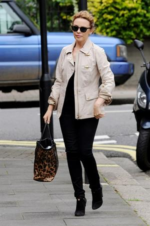 Kylie Minogue Leaving her management company in London August 30, 2012