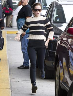 Emma Watson ...at JFK airport in NYC Sept 29, 2012