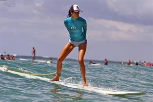 Alessandra Ambrosio surfing and eating a sno cone in Hawaii on October 12, 2011