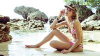 Brooke Perry in a bikini