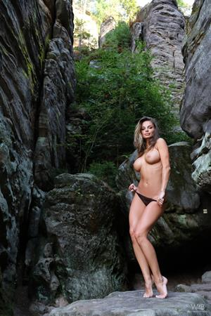 Dana Harem posing outside on the rocks