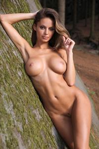 Dana Harem posing outside on the rocks