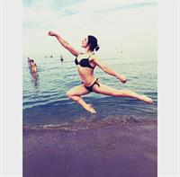 Aliya Mustafina in a bikini