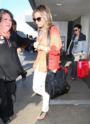 Ashley Tisdale arriving at LAX July 20, 2012
