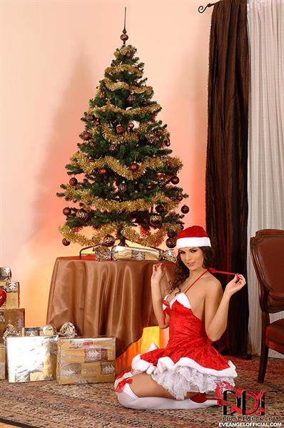 Eve Angel naked by the Christmas tree