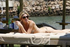 Abigail Clancy bikini candids in Italy on June 11, 2011