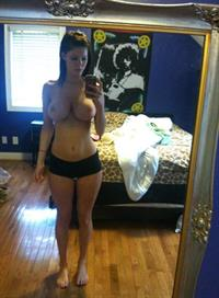 Erin Olash taking a selfie and - breasts