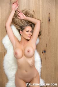 Playboy Cybergirl Anna Opsal gets nude by a staircase