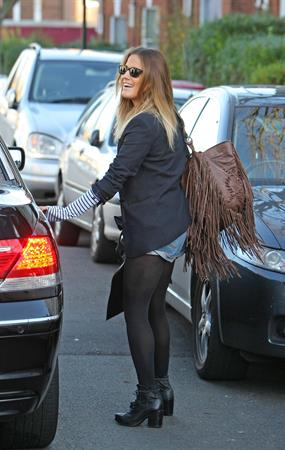 Caroline Flack leaving her London home on December 9, 2011