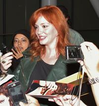 Christina Hendricks - Arriving on a flight at the Toronto International Airport - September 5, 2012