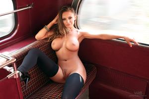 Dana Harem posing nude on a double decker bus