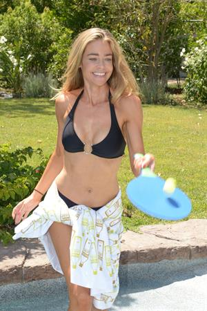 Denise Richards in a bikini at SVEDKA Colada Beach House in LA 9/18/12