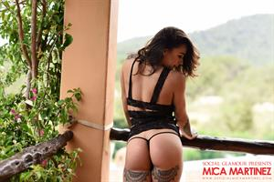 Tattooed babe Mica Martinez takes off her sexy black lingerie