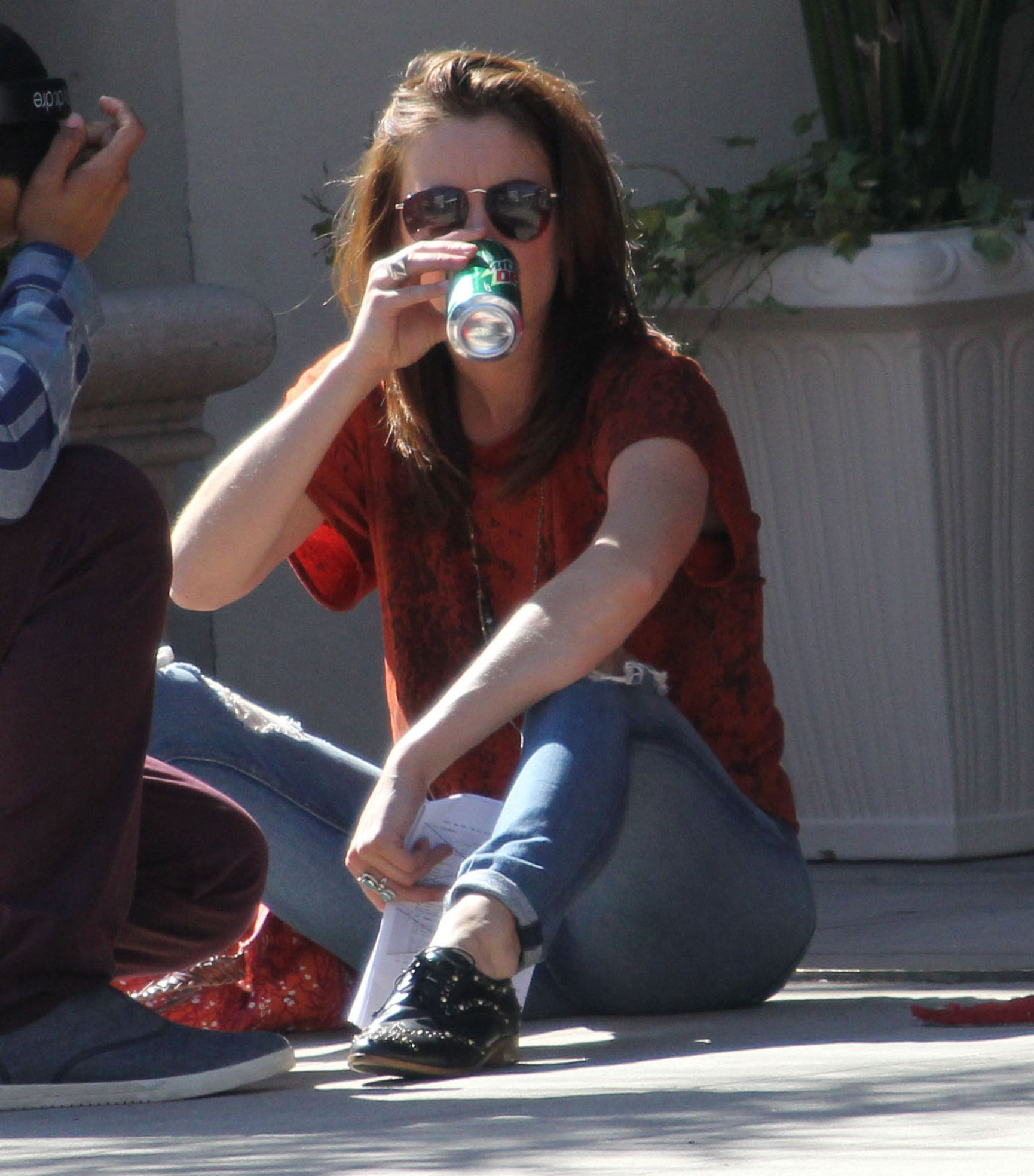 Jessica Stroup takes a break on the set of 90210 in Los Angeles on February 26, 2013