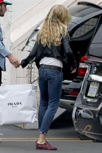 Kimberly Stewart Donating a trunk full of designer clothes at Wasteland in Los Angeles (November 15, 2012)