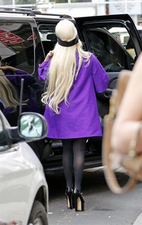 Lady Gaga holds her latest Vogue magazine cover September 2012 Issue close to her chest while out in New York City to visit a friend (07 August 2012).