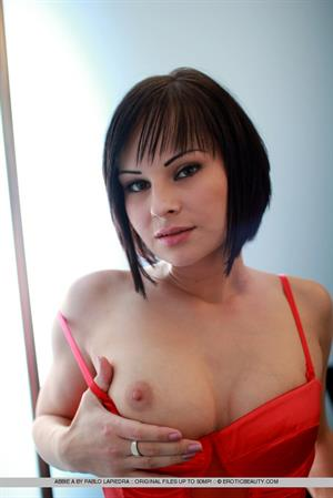 Abbie A for Erotic Beauty - Round boobs, tight labia, and firm ass in red lingerie.