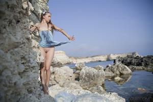 Milena D in provocative poses as she shows off her body by the beach