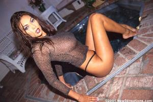 Tera Patrick stripping in a hottub