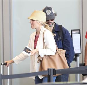 Rachel McAdams - Departs on a flight at LAX airport - August 9, 2012