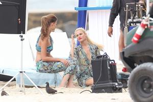 Minka Kelly and Rachael Taylor film Charlie's Angels on a beach in Miami 02-09-2011