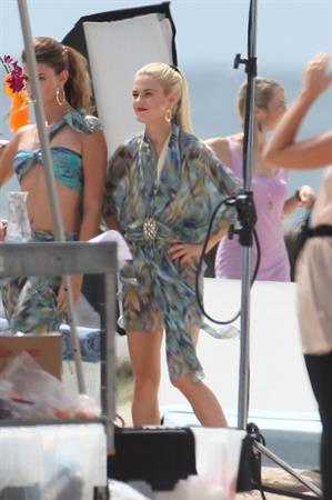 Minka Kelly and rachael taylor film charlies angels on a beach in miami 020911