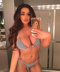 Abigail Ratchford in a bikini taking a selfie