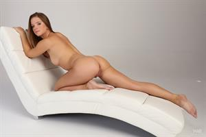 Marynia nude on a white chair